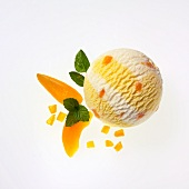 A scoop of apricot and yogurt ice cream, apricot wedges and lemon balm
