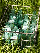 Milk bottles in a metal carrier