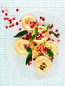 Artichoke hearts with hollandaise sauce, mint and pomegranate seeds