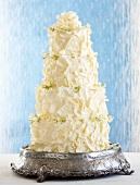 Multi-tier wedding cake with ganache and white chocolate