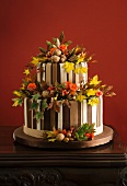 Autumnal wedding torte decorated with leaves and nuts