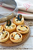 Vanilla and passion fruit tartlets and cheese and fig vol-au-vents