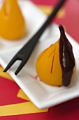 Mini poached pears with chocolate sauce for the fondue