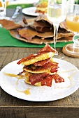 Corn fritters (deep-fried corncakes) with bacon and syrup