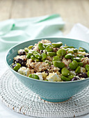 Couscous salad with chicken, broad beans, olives and feta