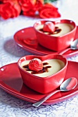 Vanilla panna cotta with strawberries in heart-shaped dishes