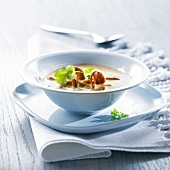 Chanterelle mushroom soup with leek and coriander