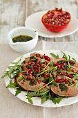 Duck breast with mint sauce, pomegranate seeds and rocket