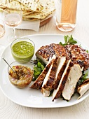 Barbecued turkey with dips, flatbread and rosé wine