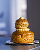 A tower of profiteroles filled with cream