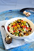 Mixed vegetable risotto with sweet bell peppers, aubergines, courgettes and parsley