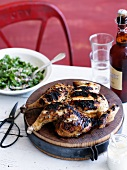 Grilled chicken on a wooden board