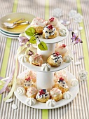 Decorated profiteroles on a cake stand