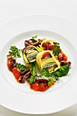 Warm potato and Mediterranean vegetables terrine with olives, tomatoes and sardines
