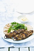 Beef kebabs with a garlic and mustard marinade and unleavened bread
