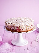 Rhubarb meringue cake on a cake stand