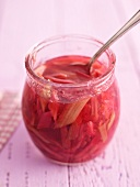 Stewed rhubarb in a jar with a spoon