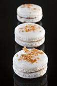 White macaroons with chocolate cream