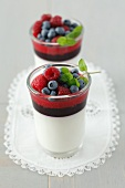 Panna cotta with blackberry and raspberry mousse and blueberries