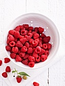 A bowl of raspberries, seen from above