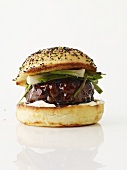 Asian Burger on a Sesame Seed Bun; White Background