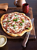 Rustic Pizza with Fresh Basil Leaves