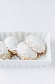 Kourambiedes (Greek almond shortbreads) in a small bowl