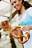 Young Woman with Glass Beer and Pretzel