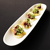 Shaved lamb, Manchego cheese and pea green hors d'oeuvres