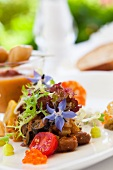 Mediterranean vegetable ragout with a mixed leaf salad and borrage flowers