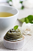 Miniature matcha-tea cake with matcha- and chestnut-flavoured icing