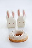 A doughnut and Easter bunnies made from paper