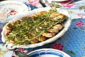Pork chops with rosemary on a serving platter