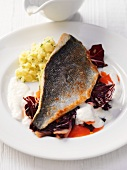 Sea bream fillet on a bed of radicchio with a potato salad