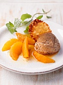 Mocha ice cream with orange ragout and a wafer