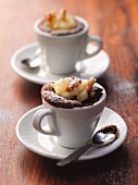 Chocolate puddings in cups with a pear and nut compote