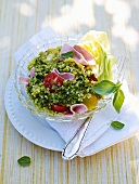 Bulgur salad with basil, ham and tomatoes