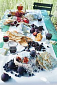 A table laid for a harvest meal with cheese and wine