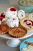 Caramelised lemon tarts and white chocolate & raspberry tarts