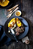 Grilled steak with pumpkin, garlic and chilli sauce