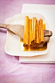 Cinnamon sticks on a wooden spoon