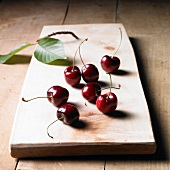 Cherries on a wooden board