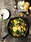 Fried potato and spinach with fried egg