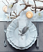 A Christmas place setting with an orchid