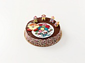 A birthday cake decorated with clowns