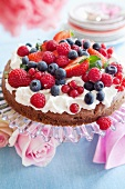Chocolate cake with cream cheese and berries