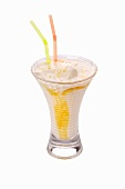 An apricot shake with two straws