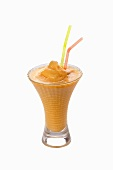 An apricot shake with straws