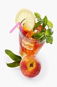 Iced tea with peach, lemon and mint