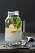 Crushed ice with lemon cake and mint in a screw-top jar